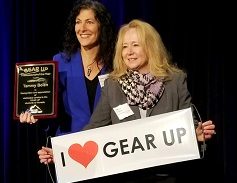 Tammy Bolen with I love Gear poster and another woman holding I love gear up sign