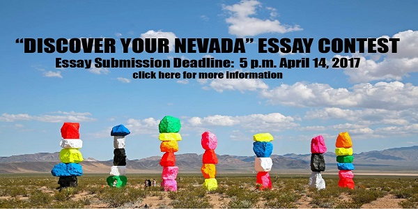 Desert with art and people walking around with cloudy skies and discover your nevada essay context click here in text