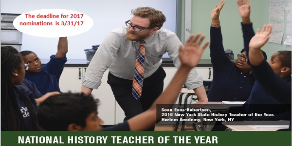 male teacher in classroom with kids hands raised with deadline for nominations for history teacher of the year is 3/31/17